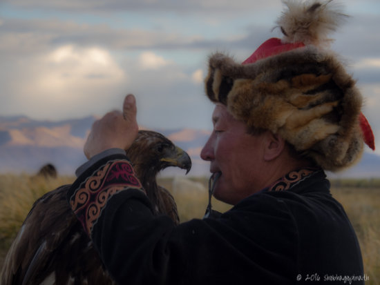 "Shobha Gopinath Eagle-hunter, Bashakhan and his beloved eagle, 'White Necklace"", Mongolia"